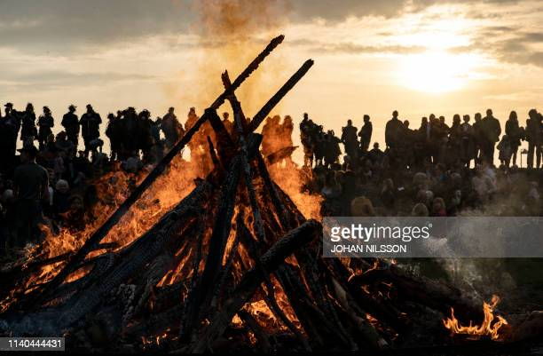 People gather around a May bonfire celebrating Walpurgis Night in Malmo southern Sweden on April 30 2019 Walpurgis Night in Sweden is a traditional...