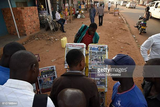 People gather around a newspaper stand to read the local daily papers on February 17 2016 ahead of tomorrows presidential elections President...