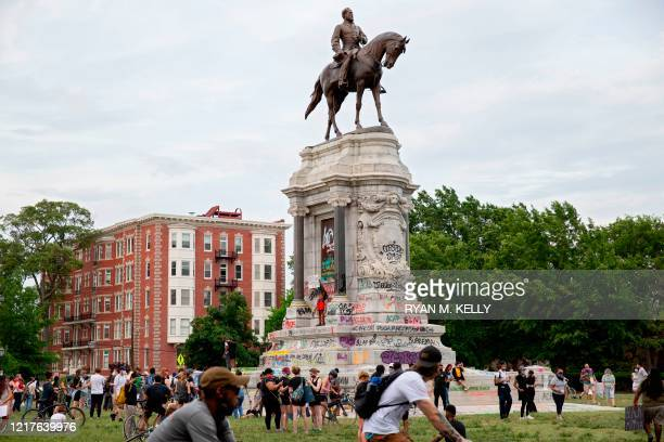 People gather around at the Robert E Lee statue on Monument Avenue in Richmond Virginia on June 4 amid continued protests over the death of George...
