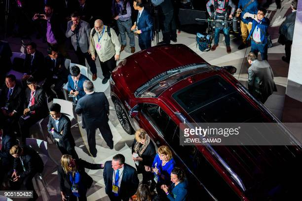 People gather around the 2018 North American Truck of the Year Lincoln Navigator at the 2018 North American International Auto Show in Detroit...