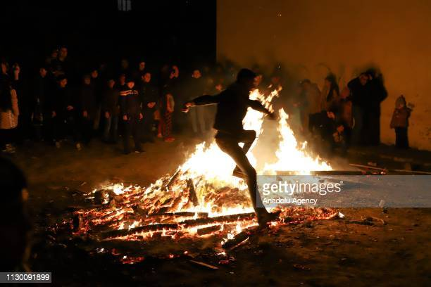 People gather around the bonfire as part of the Newroz celebrations marking the arrival of spring in Baku Azerbaijan on March 12 2019