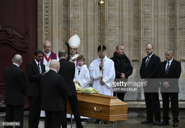 People gather around the coffin of French chef Paul Bocuse as it sits in front of the SaintJean Cathedral in Lyon at the end of the funeral ceremony...