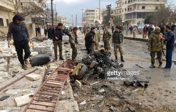 People gather around the explosion site after an attack with a bomb laden vehicle killed 1 and injured 10 civilians in Afrin district of Aleppo Syria...