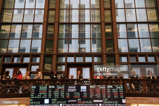 People gather around the floor of the New York Stock Exchange on the evening of November 7 2018 in New York City Stocks rose over 500 points the day...