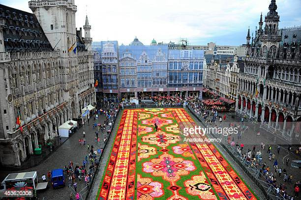 People gather around the giant carpet made with 600000 begonia flowers within the celebrations of the 50th anniversary of Turkish workers' migration...