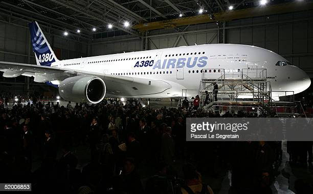 People gather around the new Airbus A380 superjumbo during its unveiling ceremony on January 18 2005 in Toulouse France The doubledecker aeronautical...