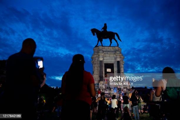 People gather around the Robert E Lee statue on Monument Avenue in Richmond Virginia on June 4 amid continued protests over the death of George Floyd...