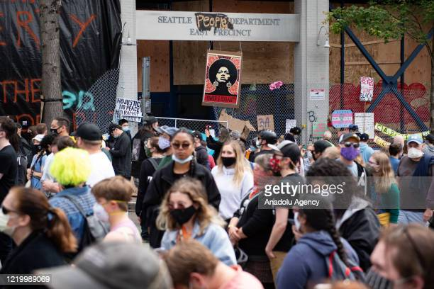 People gather around the Seattle Police Departmentâs East Precinct inside the âCapitol Hill Organized Protestâ formerly known as the âCapitol Hill...