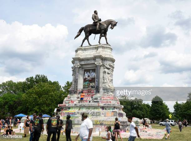 People gather around the statue of Confederate General Robert E Lee on Monument Avenue on June 6 2020 in Richmond Virginia amidst protests to remove...