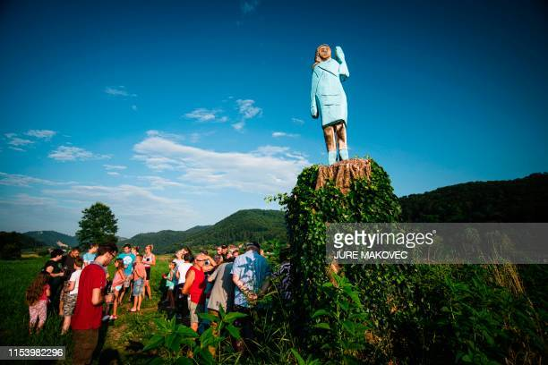 People gather around what conceptual artist Ales 'Maxi' Zupevc claims is the first ever monument of Melania Trump set in the fields near the town of...