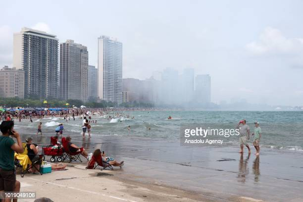 People gather as aircrafts perform over Lake Michigan during the 60th Chicago Air and Water Show in Chicago United States on August 18 2018 Aerostars...