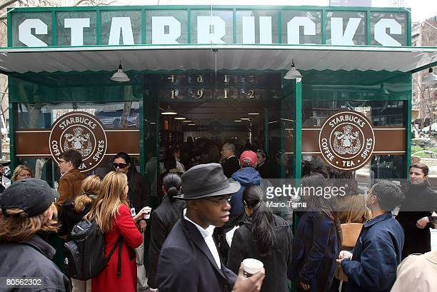 People gather as free samples of Starbucks' new 'everyday' brew Pikes Place Roast are handed out in Bryant Park April 8 2008 in New York City...