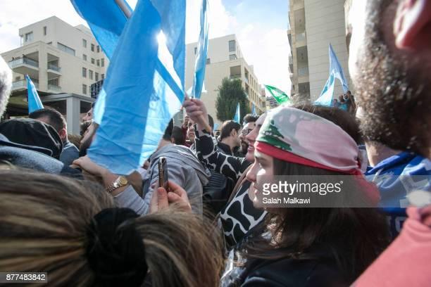 People gather as Lebanon's Prime Minister Saad Hariri makes a public appearance at his home Beit alWasat November 22 2017 in Beirut Lebanon Hariri...