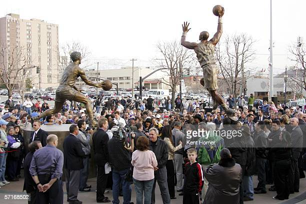 People gather as retired power-foward Karl Malone speaks at the unveiling of the statue commissioned by the Utah Jazz owner Larry H. Miller on March...