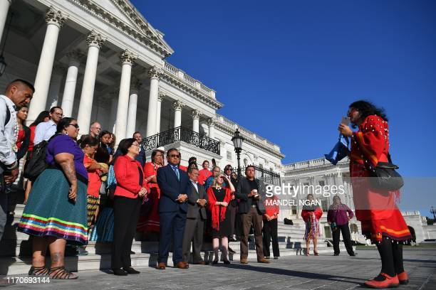 People gather as the Administration for Native Americans at the Health and Human Services Department, the National Council of Urban Indian Health,...