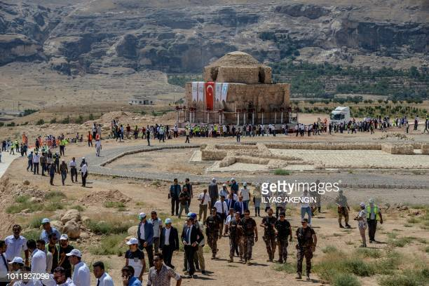 People gather as the Artuklu Hamam a centuriesold bath house weighing 1600 tonnes is loaded onto a wheeled platform and moved down a specially...