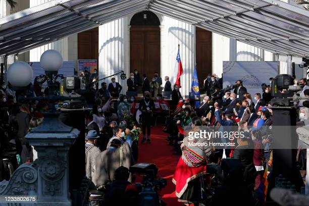 People gather as the constituent Convention ceremony is suspended due to incidents and arrests around the ex national congress before the opening...