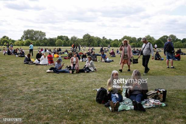 People gather as they demonstrate against the coronavirus lockdown in Hyde Park on May 16 2020 in London United Kingdom The prime minister announced...
