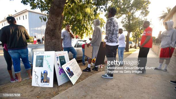 People gather at a growing memorial during a vigil for Lionel Gibson in Long Beach CA on Wednesday May 18 2016 A couple dozen family friends and...
