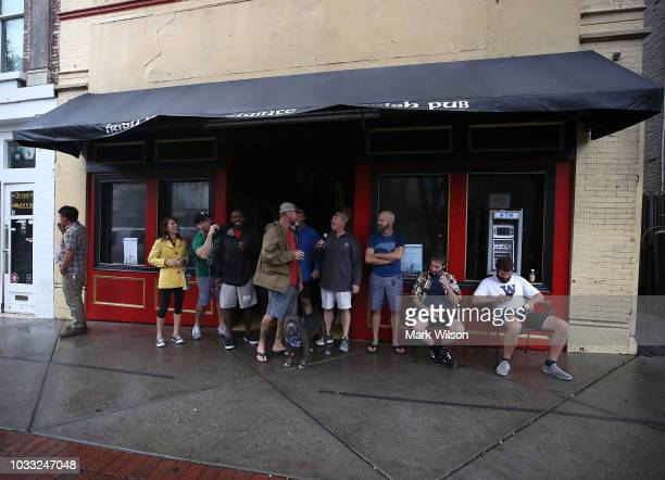 People gather at a Irish pub after Hurricane Florence hit the area on September 14 2018 in Wilmington North Carolina Hurricane Florence hit...