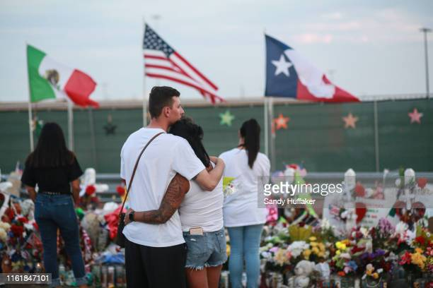 People gather at a makeshift memorial honoring victims outside Walmart August 15 2019 in El Paso Texas 22 people were killed in the Walmart during a...