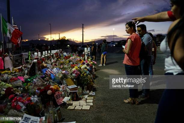 People gather at a makeshift memorial honoring victims outside Walmart August 15, 2019 in El Paso, Texas. 22 people were killed in the Walmart during...