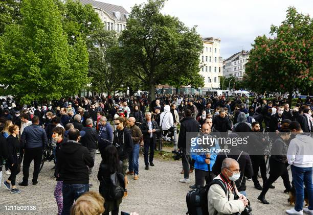 People gather at a May Day protest during the novel coronavirus pandemic on May 1 2020 at Oranien Square in Kreuzberg Berlin Germany May Day protests...