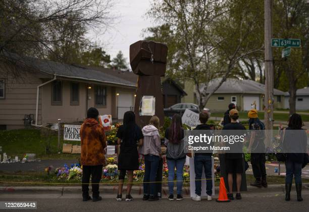 People gather at a memorial for Daunte Wright on May 2, 2021 in Brooklyn Center, Minnesota. Twenty-year-old Daunte Wright was shot and killed during...