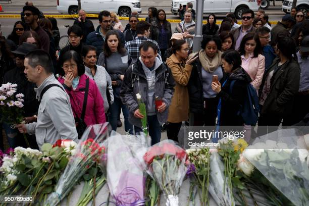 People gather at a memorial for victims of the mass killing on Yonge St at Finch Ave on April 24 2018 in Toronto Canada A suspect identified as Alek...