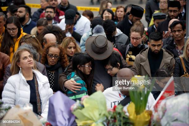 People gather at a memorial for victims of the mass killing on Yonge Street at Finch Avenue on April 24 2018 in Toronto Canada A suspect identified...