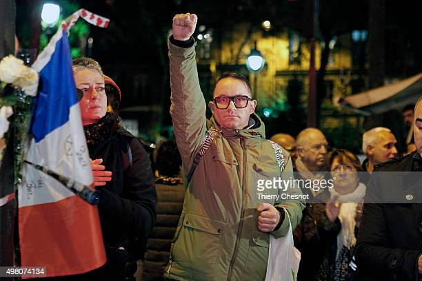 People gather at a memorial set-up near the Bataclan theatre in Paris, to pay respects to the victims of a series of deadly attacks on November 20,...