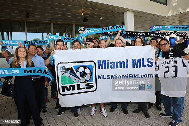 People gather at a press conference to announce David Beckham's plans to launch a new Major League Soccer franchise at PAMM Art Museum on February 5...