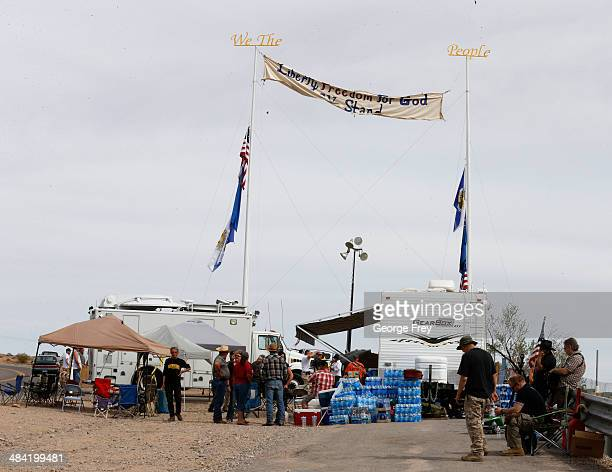 People gather at a protest area along US 170 April 11 2014 west of Mesquite Nevada Bureau of Land Management officials are rounding up Cliven Bundy's...