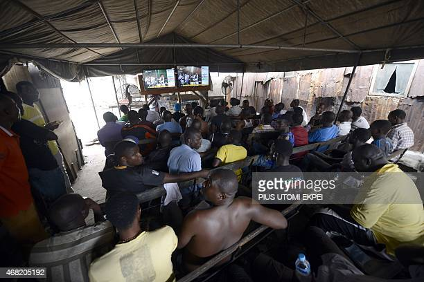 People gather at a public viewing centre in the Obalende district of Lagos on March 31 2015 to follow developments as partial results of the Nigerian...