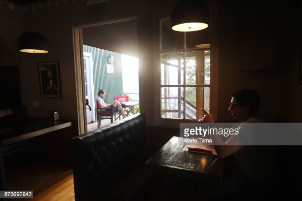 People gather at a restaurant on an unseasonably warm spring afternoon on November 5 2017 in Ushuaia Argentina Ushuaia is situated along the southern...