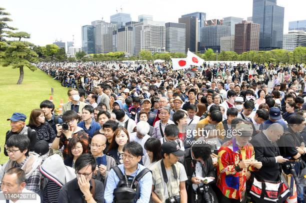 People gather at a square facing the Imperial Palace in Tokyo on May 1 the first day of Reiwa Japan's new imperial era ==Kyodo