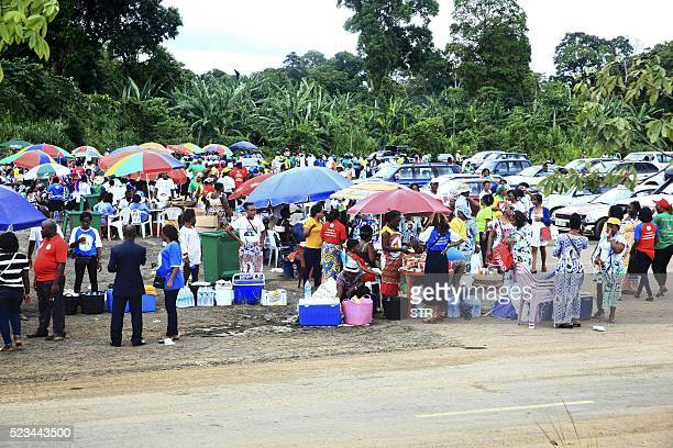 People gather at a street market in the Equatorial Guinea capital Malabo on April 22 2016 / AFP / STR