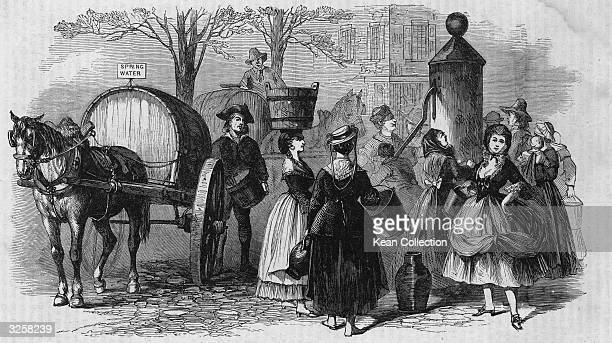 People gather at a teawater pump including one woman who balances a large bucket on her head to get a supply of water late 1700s A horsedrawn wagon...