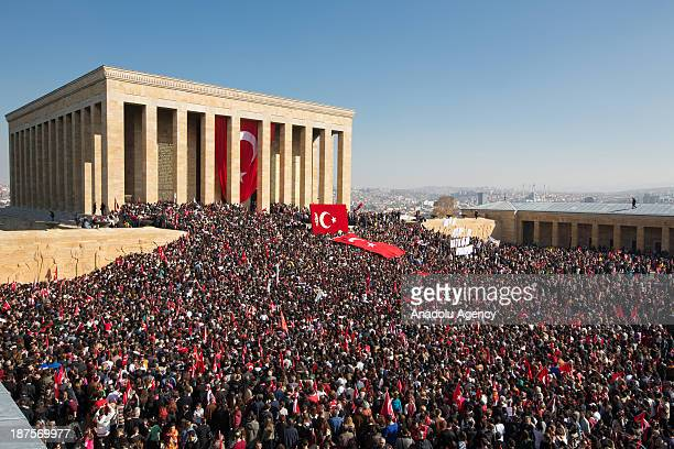 People gather at Anitkabir and wave Turkish flags during a ceremony marking the 75th anniversary of his death on November 10 2013 in Ankara Turkey...