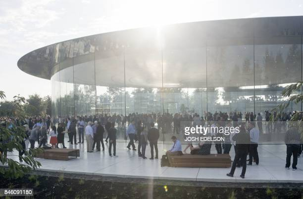 People gather at Apple's new headquarters ahead of a media event where Apple is expected to announce a new iPhone and other products in Cupertino...
