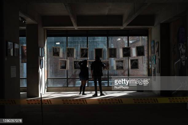 People gather at art galleries as they slowly reopen after novel coronavirus restrictions eased, on October 18, 2020 in Bogota, Colombia. Later on...