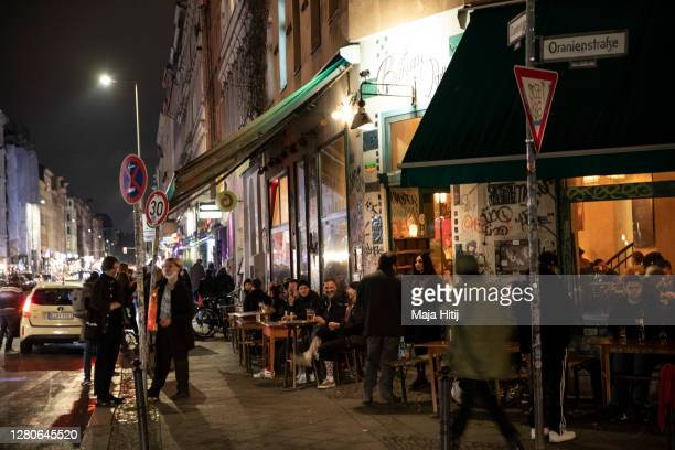 People gather at bar in Kreuzberg district on October 16, 2020 in Berlin, Germany. About 11 bars and restaurants in city led a successful challenge...
