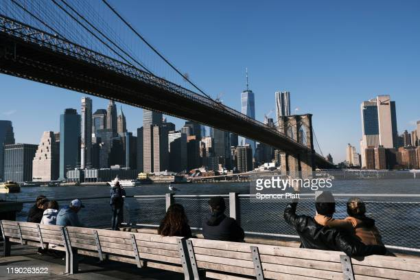 People gather at Brooklyn Bridge Park, an initiative that garnered financial and political support from former New York City Mayor Michael Bloomberg...