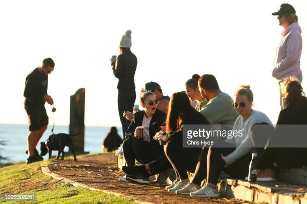 People gather at Burleigh Heads on May 02 2020 in Gold Coast Australia The Queensland government has eased COVID19 lockdown measures in response to a...