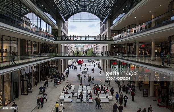 People gather at central square of LP12 Mall of Berlin a new shopping mall opened on September 25 2014 on the Leipziger Platz in Berlin One of the...