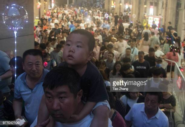 People take photos at central street to celebrate upcoming Duanwu Festival in Harbin city of China on June 172018The Dragon Boat Festival also named...