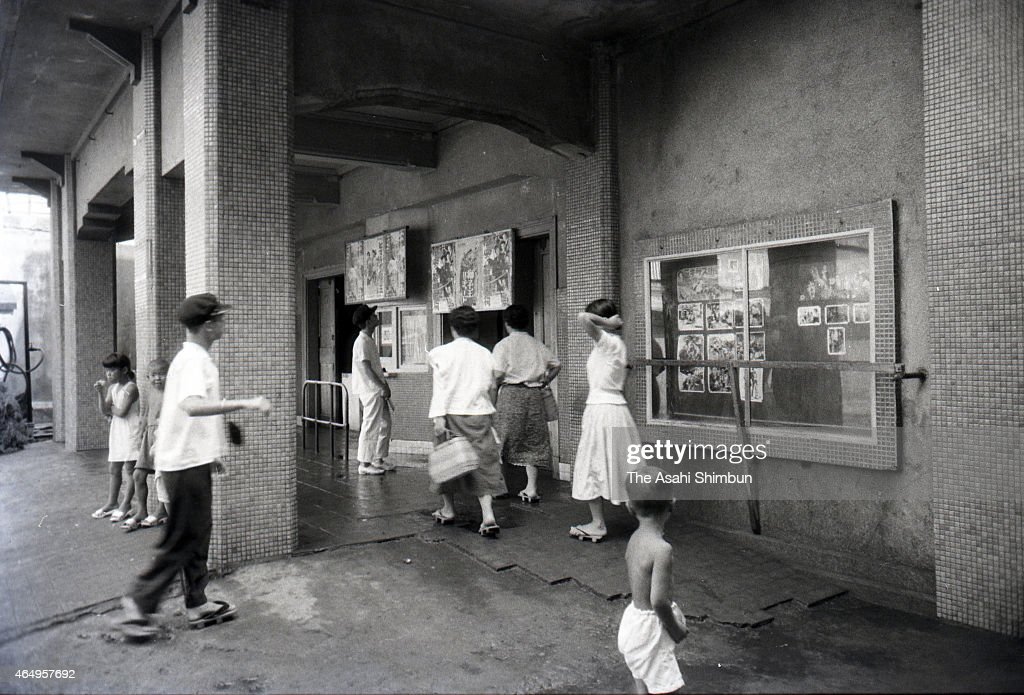 People gather at cinema 'Showakan' at Hashima on August 12, 1956 in Takashima, Nagasaki, Japan. The coal mining island, is also known as the Battleship Island, whose population used to be more than 5,000 in its heyday in 1959. In the residential area there were the Japan's first concrete building apartments.