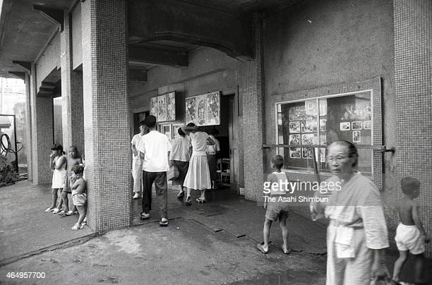 People gather at cinema 'Showakan' at Hashima on August 12, 1956 in Takashima, Nagasaki, Japan. The coal mining island, is also known as the...