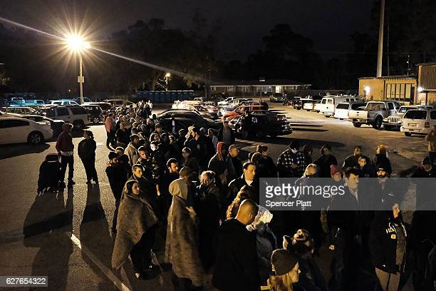 People gather at dawn most after sleeping in their cars to see a doctor at the Remote Area Medical mobile dental and medical clinic on December 4...