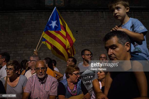 People gather at Fossar de les Moreres after the flowers offering of the President of Catalonia Artur Mas on September 10 2014 in Barcelona Spain For...